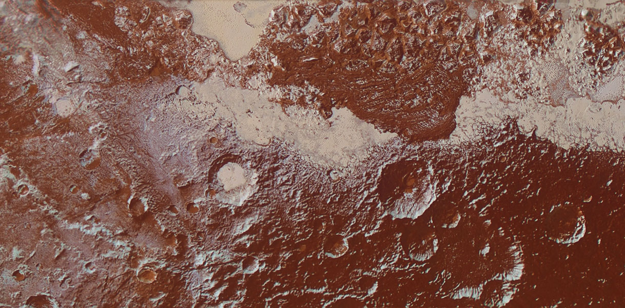 This enhanced color view from NASA's New Horizons is of Pluto's surface diversity At lower right, ancient, heavily cratered terrain is coated with dark, reddish tholins. At upper right, volatile ices fill the informally named Sputnik Planum.