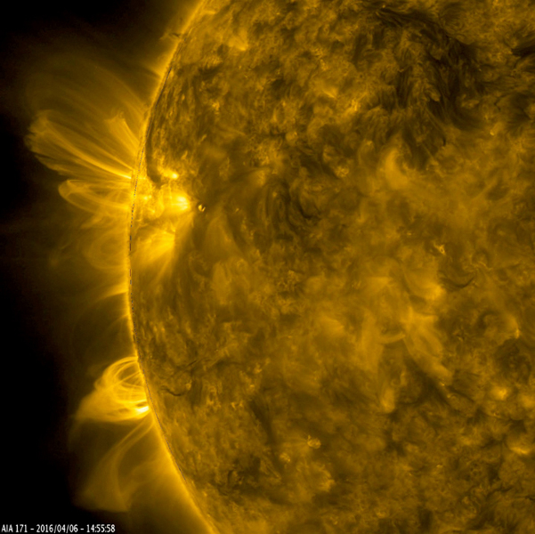 This still image from an animation from NASA's GSFC's Solar Dynamics Observatory shows arches of magnetic field lines towered over the edge of the Sun as a pair of active regions began to rotate into view (Apr. 5-6, 2016).