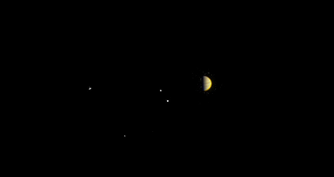 NASA's Juno spacecraft obtained this color view on June 21, 2016. As Juno makes its initial approach, the giant planet's four largest moons, Io, Europa, Ganymede and Callisto, are visible.