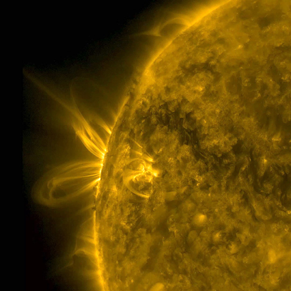 Several arcing loops rotated into view and swirled above an active region, which gave us a nice profile view of the action from NASA's Solar Dynamics Observatory on June 26-27, 2016.