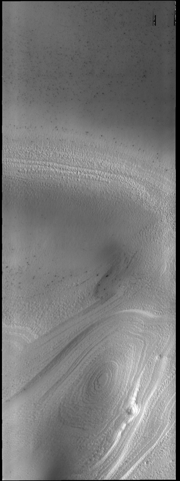 Southern hemisphere spring has arrived at the south polar cap. The ice layers that make up the cap are easily seen in this image from NASA's 2001 Mars Odyssey spacecraft.