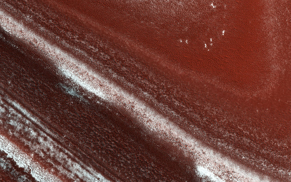 At the edge of Mars' permanent North Polar cap, NASA's Mars Reconnaissance Orbiter sees an exposure of the internal layers, each with a different mix of water ice, dust and dirt.