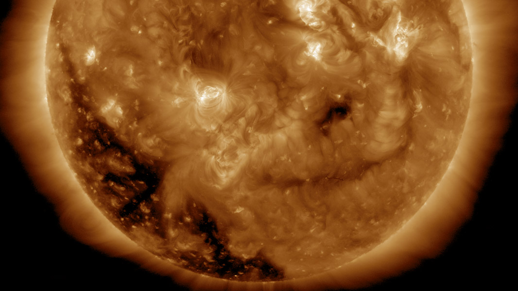 NASA's Solar Dynamics Observatory spied a substantial coronal hole begin to rotate into view over Dec. 1-2, 2016. Coronal holes are magnetically open areas of the sun's magnetic field structure that spew streams of high speed solar wind into space.