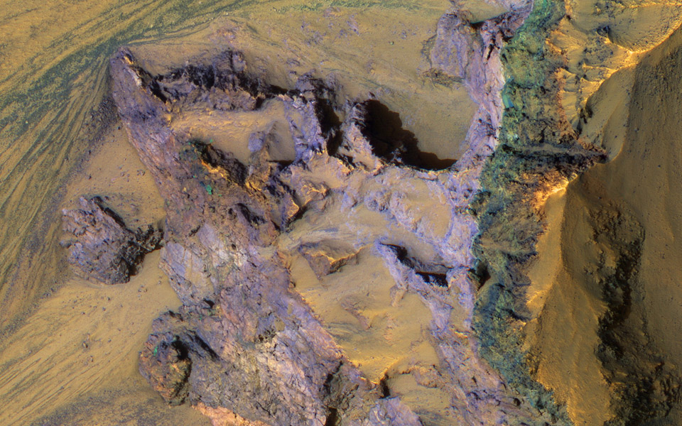 The steep walls of Valles Marineris sometimes fail, creating giant landslides. This provides a clean exposure of the underlying bedrock, as seen image from NASA's Mars Reconnaissance Orbiter.