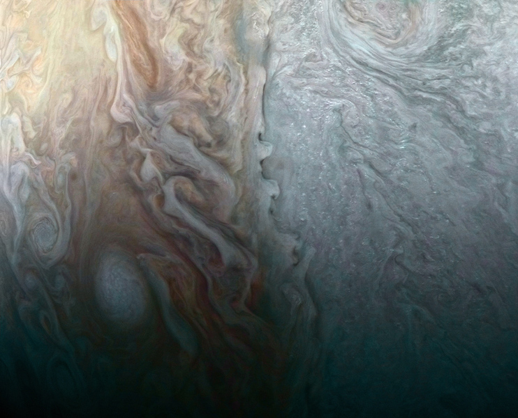 This image, taken by the JunoCam imager on NASA's Juno spacecraft, highlights a feature on Jupiter where multiple atmospheric conditions appear to collide.