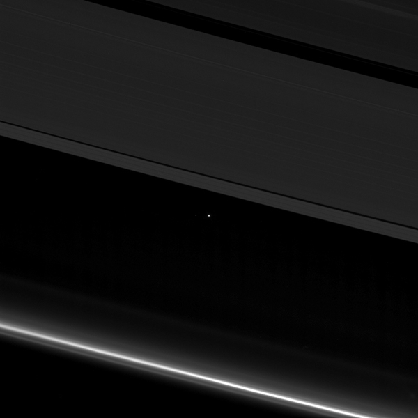 This view from NASA's Cassini spacecraft shows planet Earth as a point of light between the icy rings of Saturn. Cassini was 870 million miles (1.4 billion kilometers) away from Earth when the image was taken.