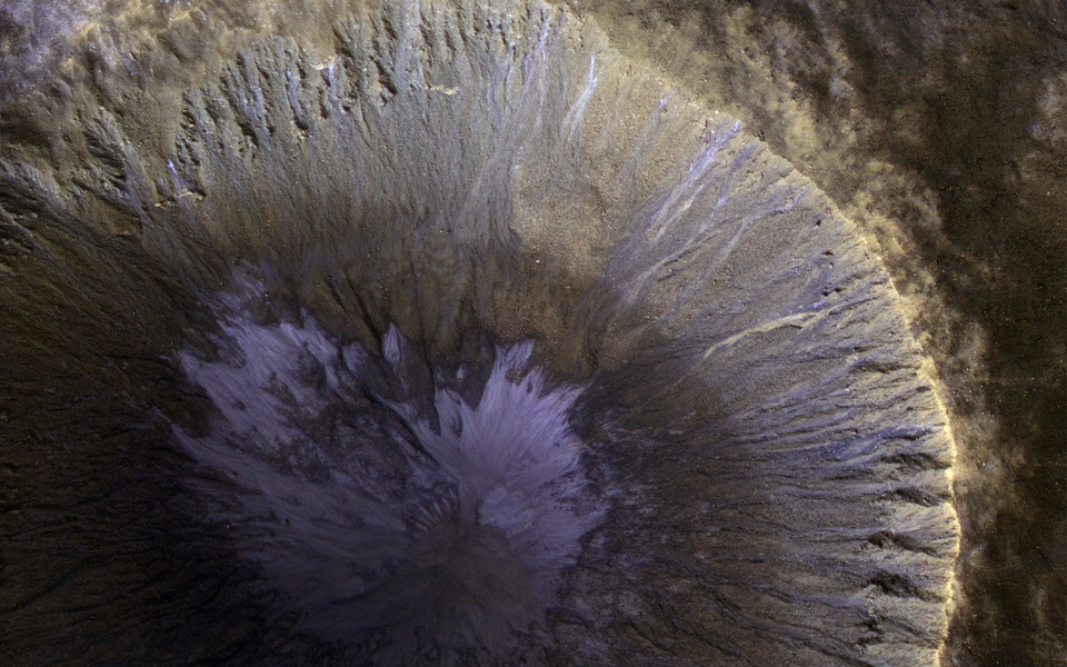 This image from NASA's Mars Reconnaissance Orbiter (MRO) shows the location with the most impressive known gully activity in Mars' northern hemisphere.