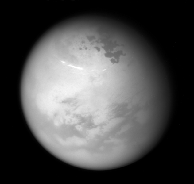 NASA's Cassini spacecraft sees bright methane clouds drifting in the summer skies of Saturn's moon Titan, along with dark hydrocarbon lakes and seas clustered around the north pole.