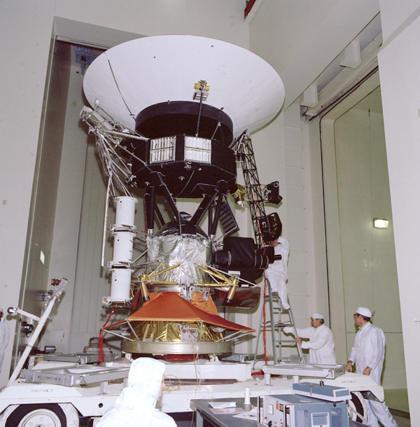 This archival photo shows engineers working on vibration acoustics and pyro shock testing of NASA's Voyager on November 18, 1976.