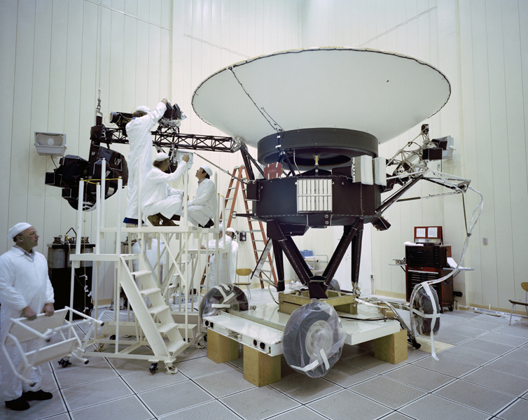 This archival photo shows engineers working on NASA's Voyager 2 spacecraft on March 23, 1977.