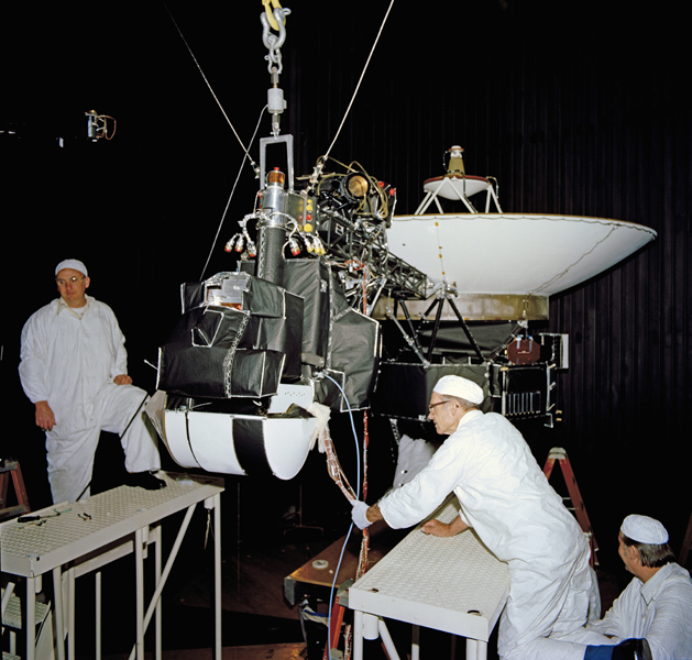 This image shows one of NASA's Voyagers in the 25-foot space simulator chamber at NASA's Jet Propulsion Laboratory, Pasadena, California. The photo is dated April 27, 1977.