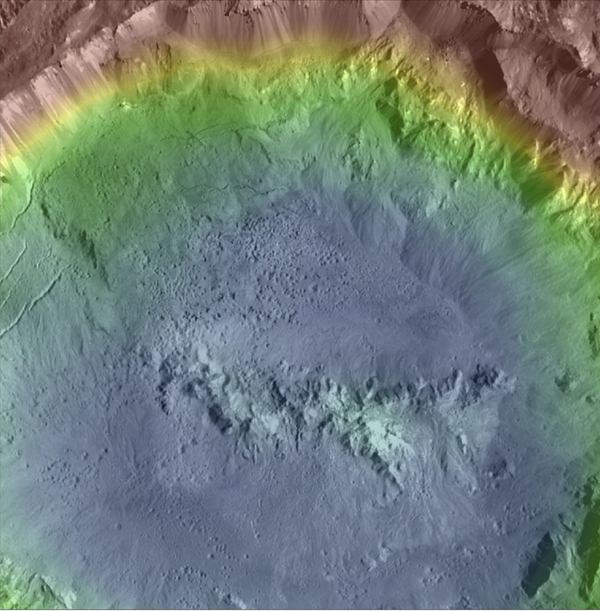Haulani Crater is one of the youngest craters on Ceres, as evidenced by its sharp rims and bright, bluish material in this enhanced color composite topographic map from NASA's Dawn spacecraft.