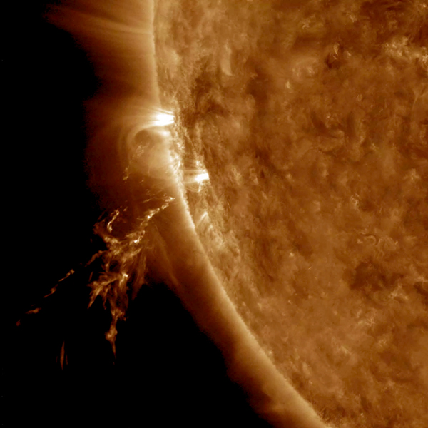 NASA's Solar Dynamics Observatory observed a small eruption on Oct. 18, 2017. The source of the blast was just out of sight beyond the edge of the sun.