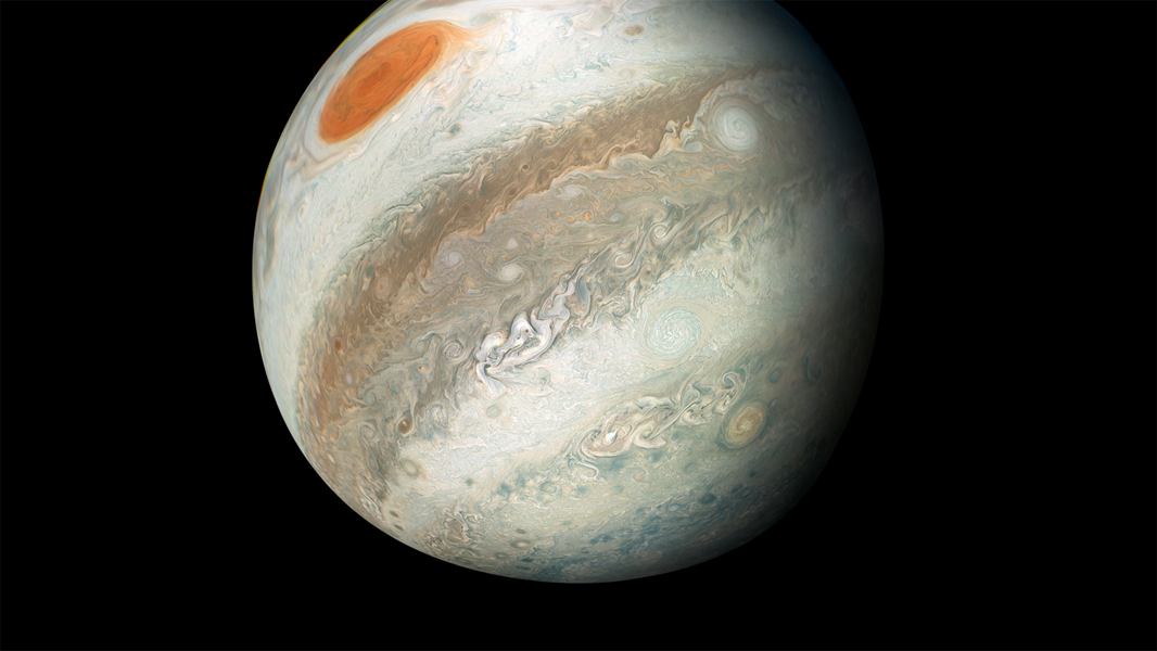 On its 12th close flyby of the gas giant planet, NASA's Juno spacecraft caught a new perspective of Jupiter from the south making the Great Red Spot appear as though it is in northern territory.