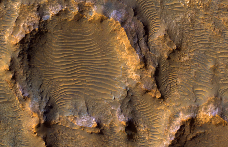 This enhanced color image from NASA's Mars Reconnaissance Orbiter shows eroded bedrock on the floor of a large ancient crater.