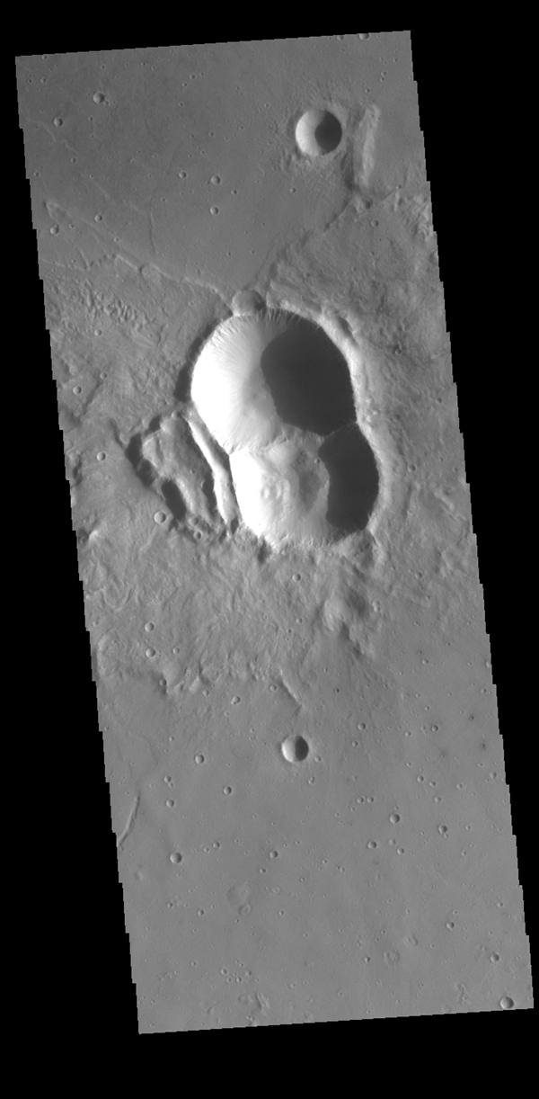 This image from NASA's Mars Odyssey shows a double impact - two meteors hitting simultaneously. The two meteors would have started as a single object, at some point prior to impact the object separated into parts.