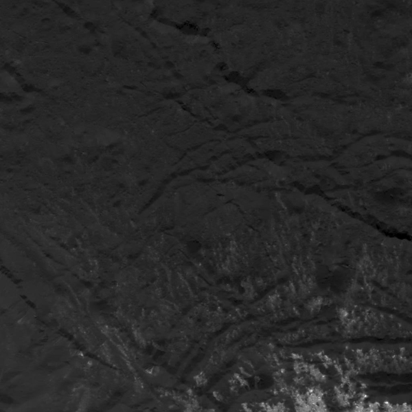 This image of a fracture pattern near Cerealia Facula on Ceres was obtained by NASA's Dawn spacecraft on July 5, 2018 from an altitude of about 33 miles (54 kilometers).