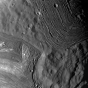 This image of Miranda, obtained by NASA's Voyager 2 on approach in 1986, shows an unusual 'chevron' figure and regions of distinctly differing terrain on the Uranian moon.