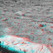 Portions of the lander's deflated airbags and a petal are at lower left in this image from NASA's Mars Pathfinder. 3-D glasses are necessary to identify surface detail.