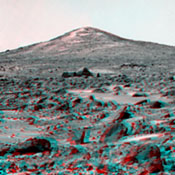 'Twin Peaks' are modest-size hills to the southwest of NASA's Mars Pathfinder landing site. They were discovered on the first panoramas taken by the IMP camera on the 4th of July, 1997. 3D glasses are necessary to identify surface detail.