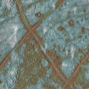 This image of Jupiter's icy satellite Europa shows surface features such as domes and ridges, as well as a region of disrupted terrain including crustal plates which are thought to have broken apart and 'rafted' into new positions.
