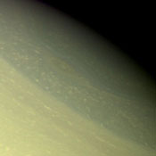 A vortex, or large atmospheric storm, is visible in this color composite of NASA's Voyager 2 Saturn images obtained Aug. 25, 1979 from a range of 1 million kilometers (620,000 miles).