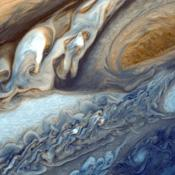 This view of Jupiter was taken by Voyager 1. This image was taken through color filters and recombined to produce the color image. This photo was assembled from three black and white negatives by the Image Processing Lab at Jet Propulsion Laboratory.