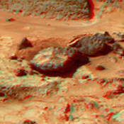 This anaglyph view of 'Flute Top' was produced by NASA's Mars Pathfinder's Imager camera. 3D glasses are necessary to identify surface detail.