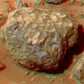 This anaglyph view of 'Grommit' was produced by NASA's Mars Pathfinder's Imager camera. 3D glasses are necessary to identify surface detail.