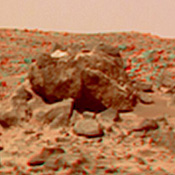 This anaglyph view of 'Half Dome,' 25 meters to the west of the Soujourner, was produced by NASA's Mars Pathfinder's Imager camera. 3D glasses are necessary to identify surface detail.