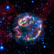 This image from NASA's Spitzer Space Telescope shows the scattered remains of an exploded star named Cassiopeia A. Spitzer's infrared detectors 'picked' through these remains and found that much of the star's original layering had been preserved.