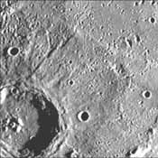This image, from NASA's Mariner 10 spacecraft which launched in 1974, shows a crater just north of the Caloris Planitia displays interior and central peaks rising up from a hilly floor.