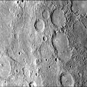 This image, from NASA's Mariner 10 spacecraft which launched in 1974, shows a broadly curved lobate scarp running from left to right in the large crater to the right of center in this image.