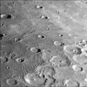 This photograph of Mercury was taken by NASA's Mariner 10 spacecraft shows smooth plains areas on Mercury that are thought to be volcanic in origin with lava flows filling in heavily cratered areas.