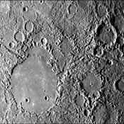 This image, from NASA's Mariner 10 spacecraft which launched in 1974, shows hilly and lineated terrain and a patch of smooth plains in a large degraded crater.