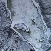 James Bay lies at the southern end of Hudson Bay. Visible in these images captured by NASA's Terra satellite on Aug 9, 2000 and Jan. 15, 2001, are some of the many rivers that flow into the bay.