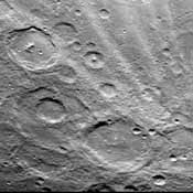 A field of bright rays, created by ejecta from a crater, radiating to the north (top) from off camera (lower right) is seen in this view of Mercury taken Sept. 21, 1974 by NASA's Mariner 10.