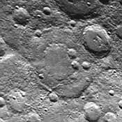 Taken about 40 minutes before NASA's Mariner 10 made its close approach to Mercury on Sept. 21,1974, this picture shows a large double-ringed basin (center of picture) located in the planet's south polar region