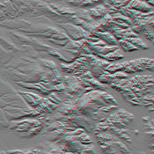 This anaglyph, from NASA's Shuttle Radar Topography Mission, shows the Kamchatka Peninsula in eastern Russia. Sredinnyy Khrebet, the mountain range that makes up the spine of the peninsula. 3D glasses are necessary to view this image.