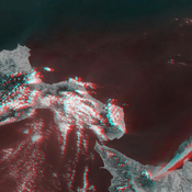 This anaglyph from the MISR instrument aboard NASA's Terra spacecraft shows the eruption of Mt. Etna volcano located near the eastern coast of Sicily on July 22, 2001. 3D glasses are necessary to view this image.