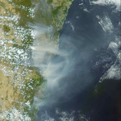 Australia's largest city of Sydney was clouded with smoke when more than 70 wildfires raged across the state of New South Wales when NASA's Terra satellite captured this image the morning of December 30, 2001.