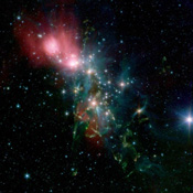 Located 1,000 light years from Earth in the constellation Perseus, a reflection nebula called NGC 1333 epitomizes the beautiful chaos of a dense group of stars being born. This image is from NASA's Spitzer Space Telescope.