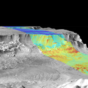 This image is a mosaic of day and night infrared images of Melas Chasma taken by NASA's Mars Odyssey spacecraft. The daytime temperature images are shown in black and white, superimposed on the Martian topography.