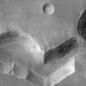 This image from NASA's Mars Odyssey spacecraft shows a sinuous valley network channel with sharp bends cutting across the cratered highlands of the southern hemisphere of Mars.