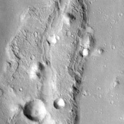This lunar-like scene, imaged by NASA's Mars Odyssey spacecraft, occurs along the southeastern rim of the Isidis Planitia basin, an ancient impact crater some 1200 km across.