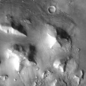 The so-called 'Face on Mars' can be seen slightly above center and to the right in this NASA Mars Odyssey image. This 3-km long knob was first imaged by NASA's Viking spacecraft in the 1970's and to some resembled a face carved into the rocks of Mars.