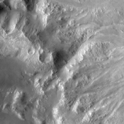 This NASA Mars Odyssey image shows the intersection of Holden Crater with Uzboi Valles. This region of Mars contains a number of features that could be related to liquid water on the surface in the Martian past.