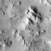 The Cerberus feature, imaged here by NASA's Mars Odyssey, is a dark region at the southeastern edge of the huge Elysium Mons volcanic complex that was visible to early astronomers because it was a distinctive dark spot on a large bright region of Mars.