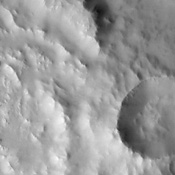 The eastern rim of this unnamed crater in Southern Arabia Terra, imaged by NASA's Mars Odyssey, is very degraded, indicating that it's an ancient crater that's been subjected to erosion and bombardment from impactors such as asteroids and comets.