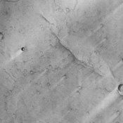 This image from NASA's Mars Odyssey spacecraft shows a location close to Mars' equator, near the southern edge of a low, broad volcanic feature called Syrtis Major.